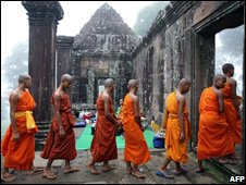 Cambodian Buddhist monks walk in line up during a prayer ceremony for peace at Preah Vihear temple, August 2008