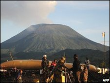 Displaced people tap into a supply of water aid nearby the Nyiragongo volcano in Kibati