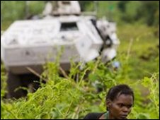 A displaced woman next to a UN armoured vehicle near Goma on Tuesday 11 November 2008