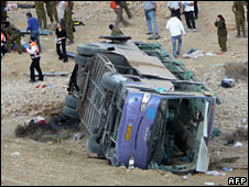 The bus lies at the bottom of the ravine