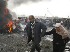 Palestinians flee the scene of an air strike in Rafah