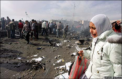A Palestinian girl cries at the site of an Israeli air strike in Rafah
