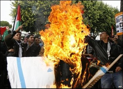 Protesters burning flags in the Cypriot capital, Nicosia