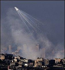Israeli artillery shells explode over the Gaza Strip