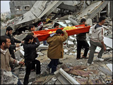 Palestinians carry the body of a relative killed in an Israeli airstrike during a funeral on 17 January 2009