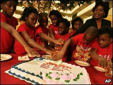 The seven surviving children of the octuplets born to Nkem Chukwu are pictured with another unidentified child and their mother as they celebrate their 10th birthday in Houston, Texas, 20 December 2008