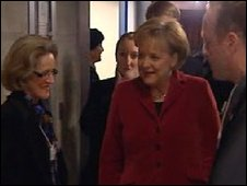 German Chancellor Angela Merkel (in red) arriving to speak in Davos, 30 January