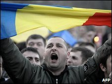 Anti communist demonstrator with Romanian flag