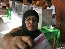 A woman votes in Jakarta, Indonesia, 9 April