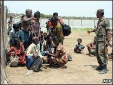 Soldier with refugees (14 May)