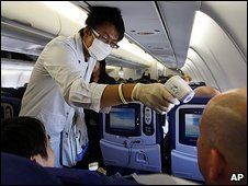 Chinese health worker tests flight from London  9.7.09