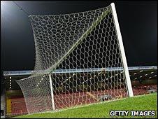 IFK Goteborg keeper moves the goalposts