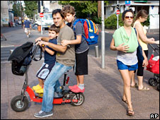 Family on electric scooter
