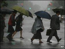 Commuters in dark rain, downtown Tokyo, 8 Oct 09