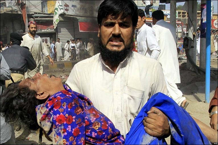 Injured person is carried after the blast