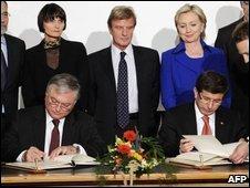 Edouard Nalbandian and Ahmet Davutoglu, signing  Credit: AFP