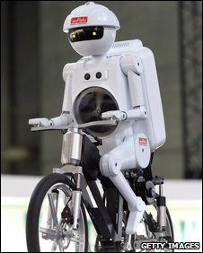 Japanese robot on a bicycle, Getty