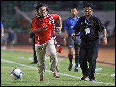 Indonesian fan Henri Mulyadi dribbles down the wing
