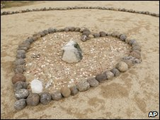 A heart memorial at the site of the sweat lodge in Angel Valley