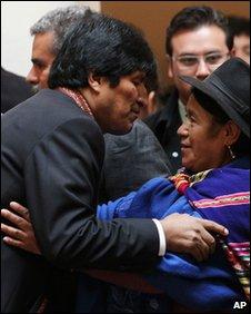 Bolivia's President Evo Morales congratulates his new Minister of Productive Development Antonia Rodriguez Medrano in La Paz on 23 Jan 2010