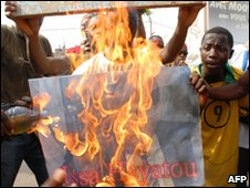 Protesters burn an effigy of the president of the Confederation of African Football Issa Hayatou during a protest march held in Lome.