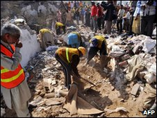 Rescuers at the site of the Lahore blast, 08 March
