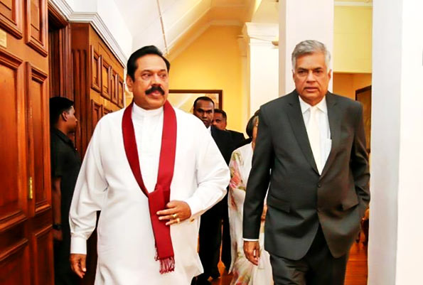 Re-instated Lankan PM and Rajapaksa set to clash over Executive Presidency and devolution of power