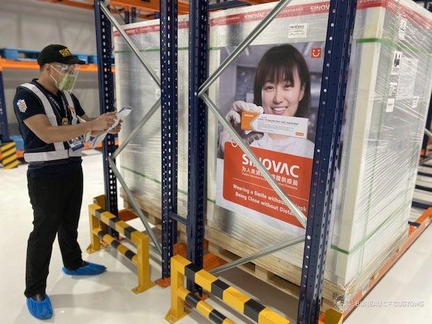 Customs worker inspect vaccine shipment
