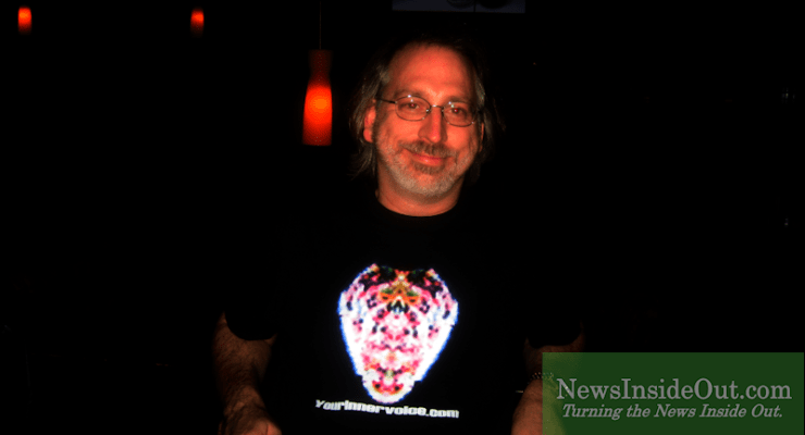 Expert clinician Jon Kelly from YourInnerVoice.com displays Baba Nam Kevalam yantra.