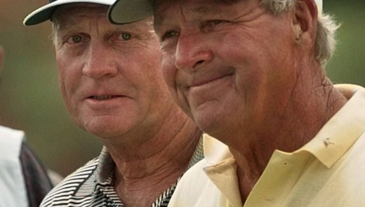 Jack Nicklaus, left, and Arnold Palmer walk off the ninth hole after both making birdie during first round play of the PGA Seniors' Championship at the PGA National in April 1998. (Hans Deryk/Associated Press)