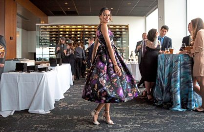 Christina Salgado twirls her dress and poses for a portrait at Mark Flaherty and Mary McKinney's wedding on Sunday, Oct. 23, 2017 at Monterey Bay Fish Grotto in Mount Washington. (Antonella Crescimbeni/Post-Gazette).