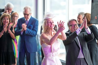 Mark Flaherty and Mary McKinney clap for the band during their wedding on Sunday, Oct. 23, 2017 at Monterey Bay Fish Grotto in Mount Washington. (Antonella Crescimbeni/Post-Gazette).