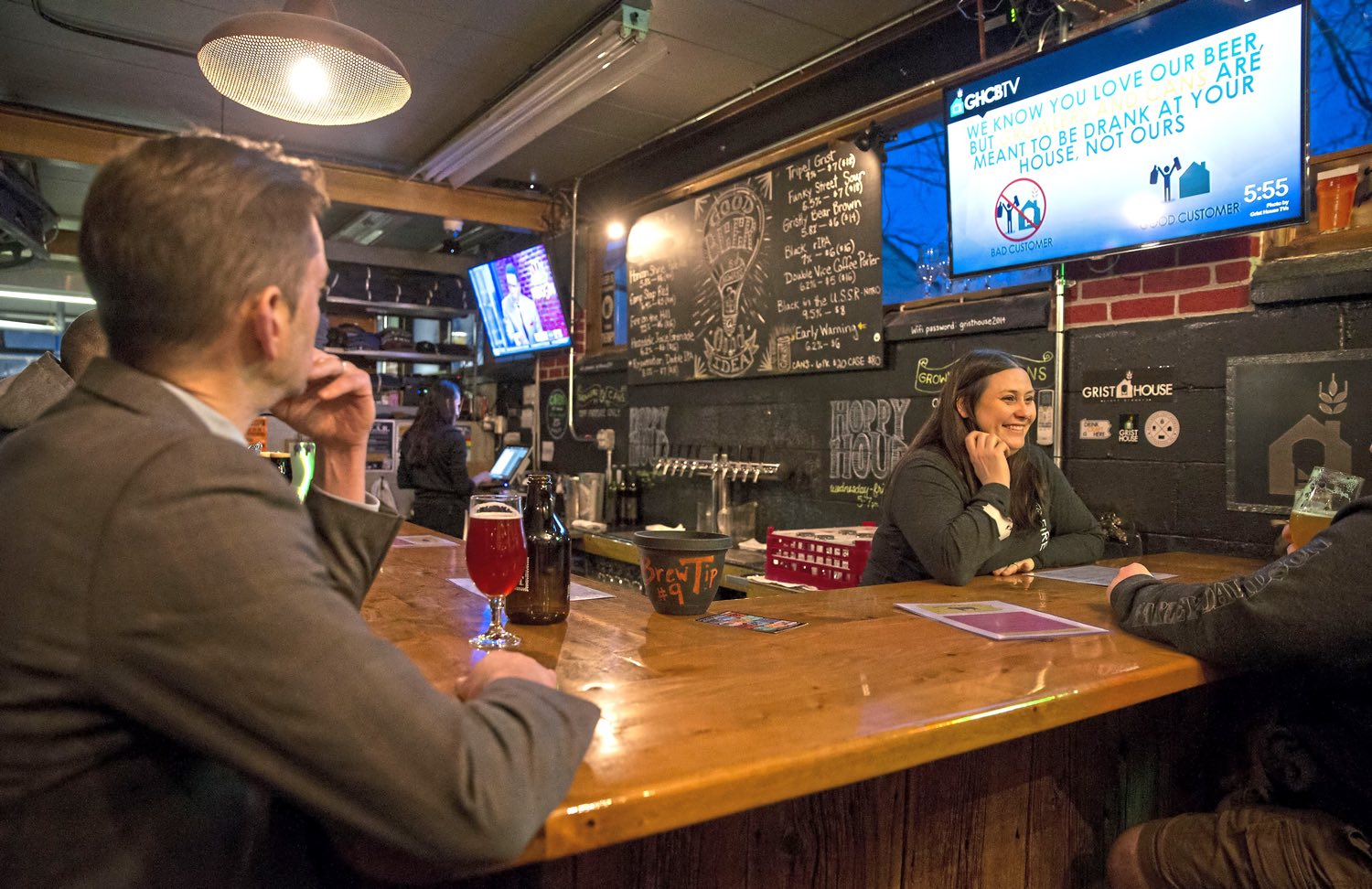 Bartender Jami Spatta chats with patrons at the Grist House Craft Brewery, as part of the Distinction Series, on Tuesday, Jan. 30, 2018 in Millvale. (Antonella Crescimbeni/Post-Gazette)