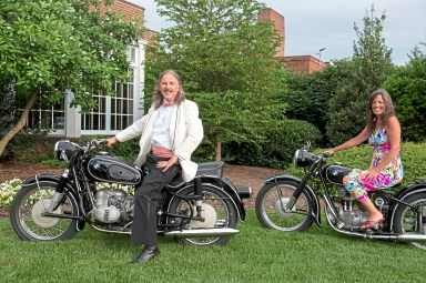The Rev. Joseph Baird and Kathy Baird pose on their 1962 and 1955 BMW motorcycles at the 2017 Pittsburgh Vintage Grand Prix Black Tie & Tailpipes party. (Steph Chambers/Post-Gazette)
