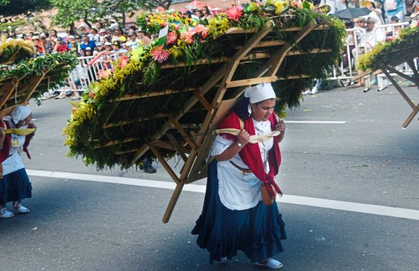 "A woman carries an elaborate flower arrangement on a wooden ""silletas"" Monday Aug. 7, 2017, during the 60th anniversary of the flower festival in Medellin, Colombia. (Nate Guidry/Post-Gazette)"