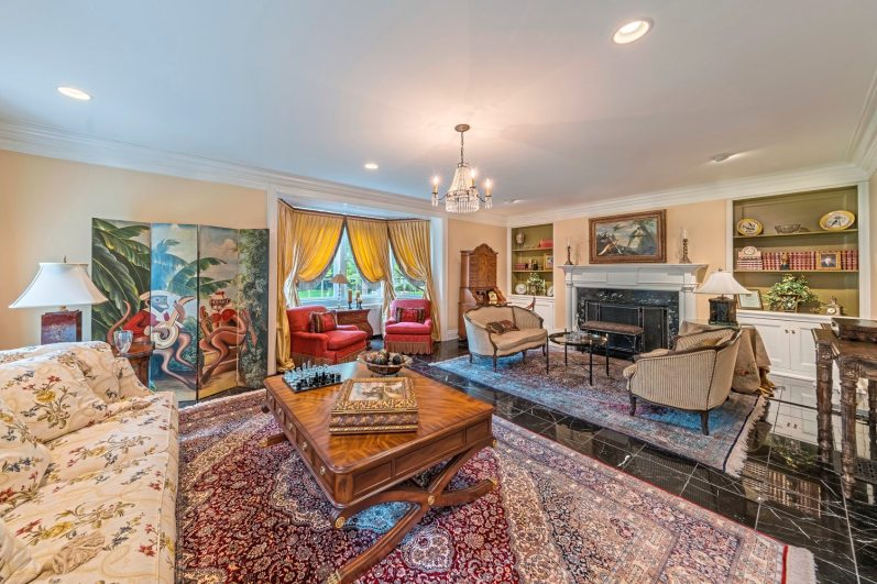 The living room with marble floor, working fireplace and large bay window just off the center hall at 5228 Westminster Road, Shadyside. (Howard Hanna Real Estate)