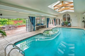 The all year round indoor/ outdoor pool and hot tub at 5228 Westminster Road, Shadyside. (Howard Hanna Real Estate)