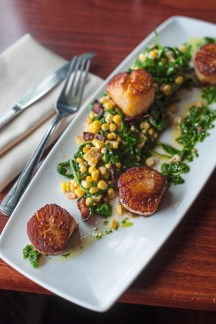Seared scallops with bacon, corn, oregano, chimichurri, and arugula, served at Biba on Tuesday, Aug. 23, 2018, in Beaver. (Stephanie Strasburg/Post-Gazette)