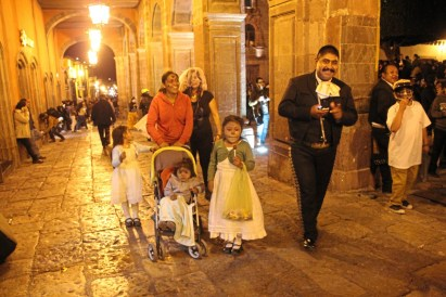 Distinction A family strolls through the main square in San Miguel de Allende, Mexico during the evening festivities for Day of the Dead. credit Patricia Sheridan