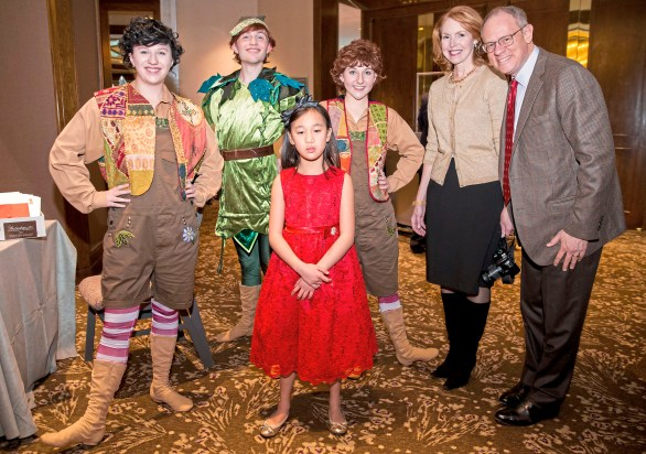 Peter Pan characters pose with Tao Goetz, center, and her parents, Julie Maloney and John Goetz at Pittsburgh Mercy's 2017 Reindeer Ball. (Antonella Crescimbeni/Post-Gazette)