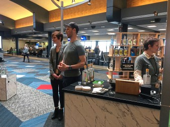 Co-owners Sarah, left, and Ryan Kanto with colleague Rachel Melh at the opening of their Quantum Spirits kiosk in Terminal B at the Greater Pittsburgh International Airport on Oct. 23. (Bob Batz Jr./Post-Gazette)