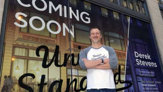 Chef Derek Stevens, stands out front of Union Standard restaurant he is opening in the old Union Trust building. The restaurant will be housed on the ground and mezzanine floors, and will overlook Mellon Park. (Nate Guidry/Post-Gazette)