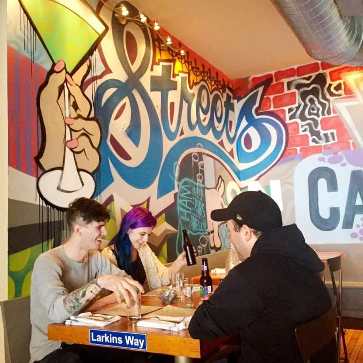 Patrons enjoy lunch at Streets on Carson, on the South Side. (Dan Gigler/Post-Gazette)