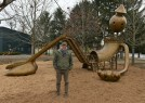 """Artist Tom Otterness with his sculpture """"Playground"""" at the Aspinwall Riverfront Park."""