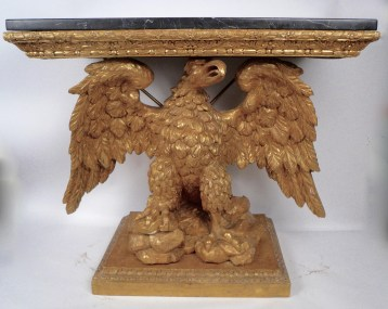 This important pair of mirror image, carved and gilt wood marble top console tables in the manner of William Kent were purchased in the mid 1980s from a leading London dealer. They were bought to grace the entrance hall of Penderyn on Marylandîs Eastern Shore, the home of Maureen and Mario Boiardi of Chef Boyardee. Price: $48,000