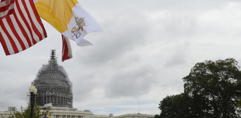 The flag of the Vatican City flies along with the U.S. flag and District of Columbia flag along Constitution Avenue outside the U.S. Capitol in Washington, D.C., Tuesday, Sept. 22, 2015.