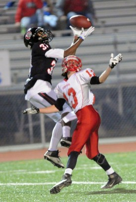 Aliquippa Antwan Brooks makes a catch and scores the first touchdown of the game. Martinsburg Central Larry Corle, right. John Heller/Post-Gazette photos