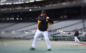 Pirate manager Clint Hurdle warms up his players with some fielding. (Steve Mellon/Post-Gazette)