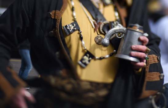 Chris Miller is decked out in some very cool Pirate gear at a tailgate party. (Steve Mellon/Post-Gazette)