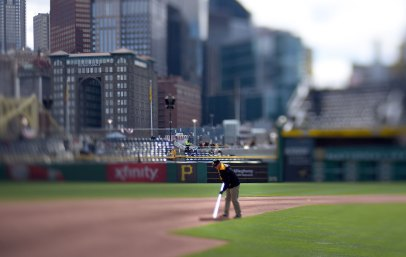 Groundskeepers prepare the field an hour before the game. (Steve Mellon/Post-Gazette)